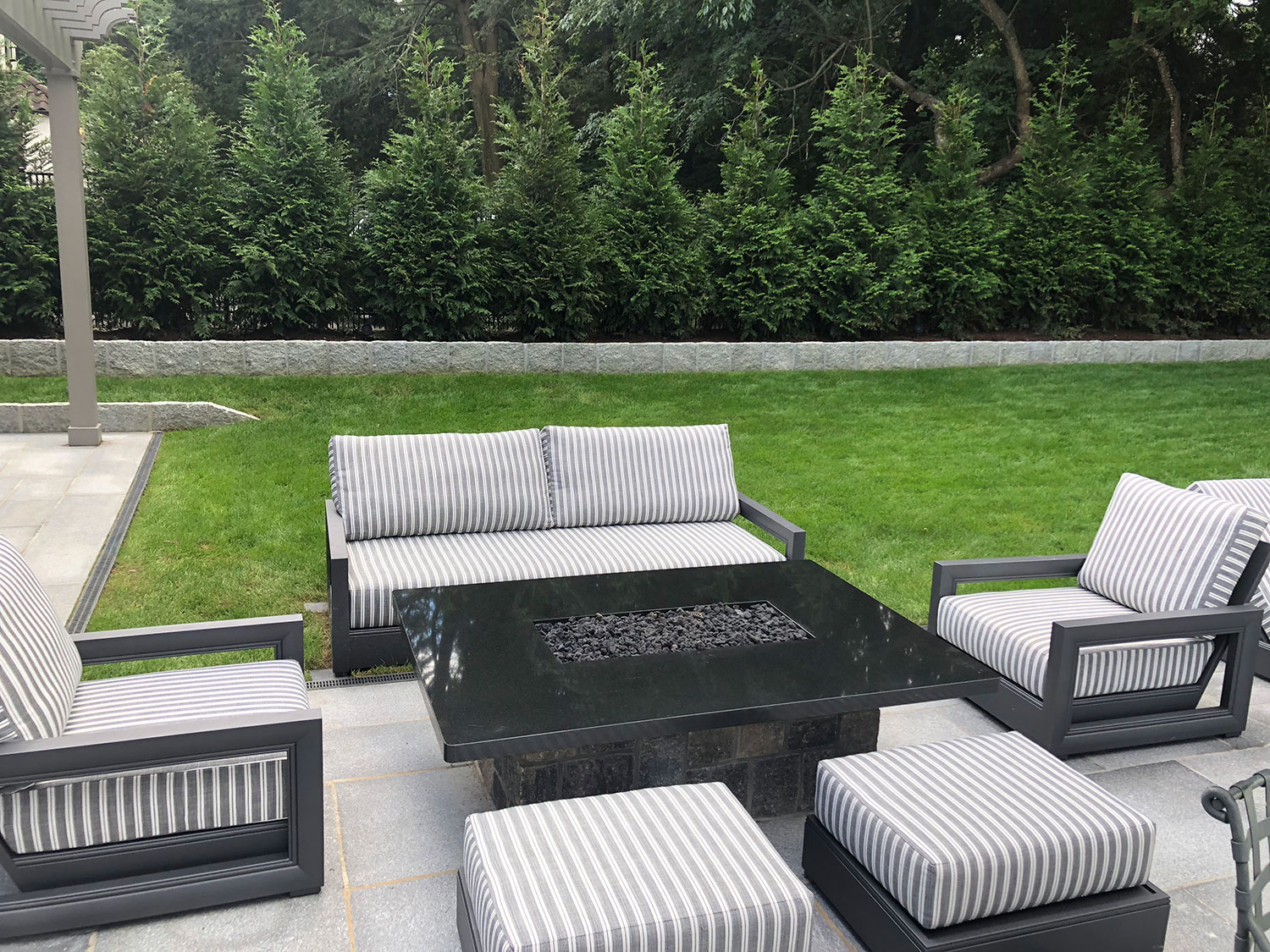 Fire pit , landscape design , evergreen screening